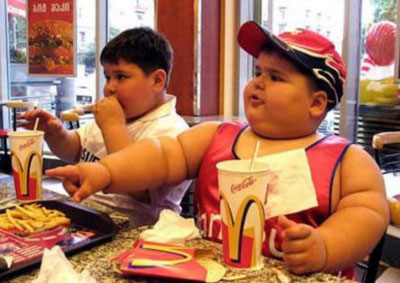 Now famous image of two kids working their way through Big Macs